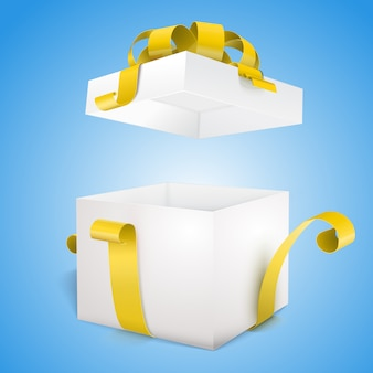 Otwórz pudełko i żółty łuk i wstążkę