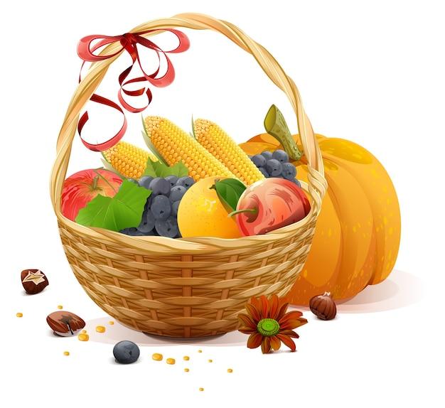 Owoce i warzywa w wiklinowym koszu. bogate zbiory na święto dziękczynienia. na białym tle