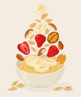 Owsianka owsiana w misce z bananami, jagodami, truskawkami, orzechami i zbożami na białym tle. zdrowe śniadanie