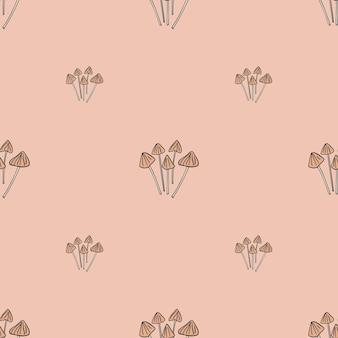 Ozdobny wzór z elementami grzyba łusicy lancetowatej psilocybe. różowy jasny tło. ilustracji. projekt wektor dla tekstyliów, tkanin, prezentów, tapet.