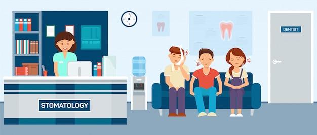 Pacjenci z bólem zęba siedzi stomatologia hall