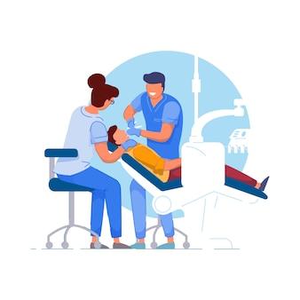 Pacjent dentysta. lekarz specjalista i asystent