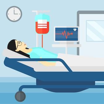Pacjent leżący w łóżku szpitalnym.