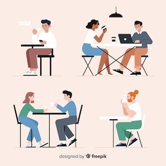 Paczka ludzi siedzących w kawiarni