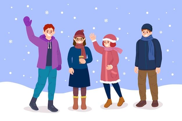 Paczka ludzi w przytulnych ubraniach zimą