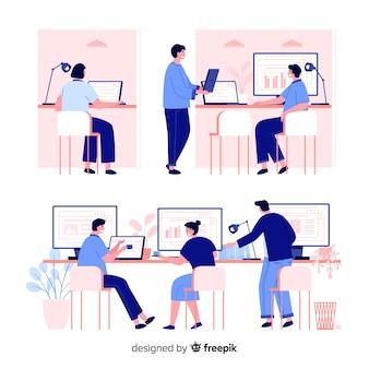Paczka pracowników biurowych siedzących przy biurkach