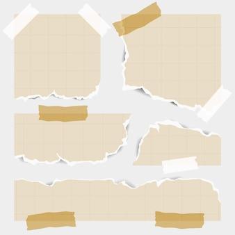 Paczka różnych kształtów podartych papierów z taśmą