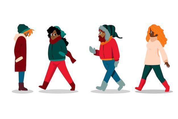Paczka różnych ludzi w przytulnych ubraniach zimą