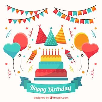 Paczka urodzinowy tort i kolorowe ozdoby