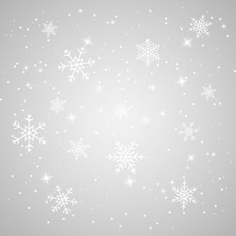 Padający śnieg z płatkami śniegu i gwiazdami