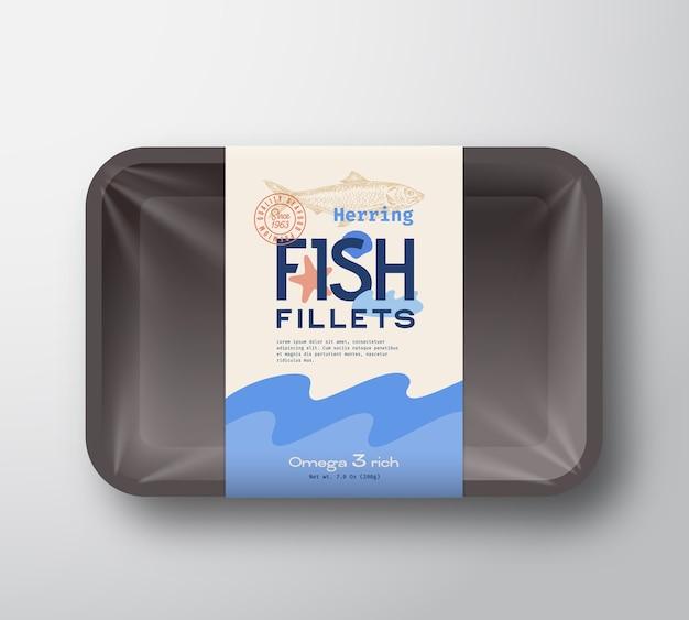 Pakiet filetów rybnych. streszczenie plastikowy pojemnik na ryby z pokrywą celofanową. etykieta opakowania.
