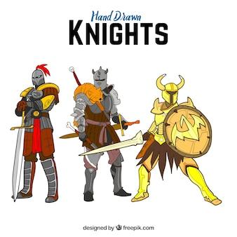 Pakiet ręcznie rysowany trzech rycerzy wojowników