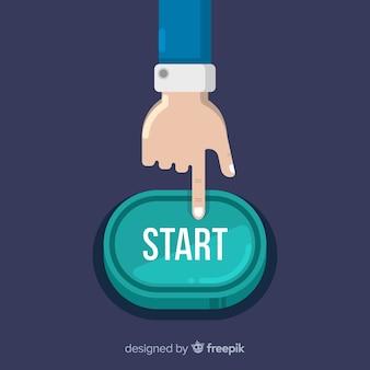 Palec naciskając zielony przycisk start