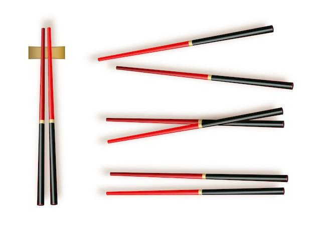 Pałeczki do jedzenia. zestaw akcesoriów do sushi na białym tle
