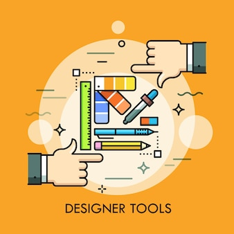 Paleta kolorów, długopis, ołówek, linijka, gumka i dwie ludzkie dłonie.