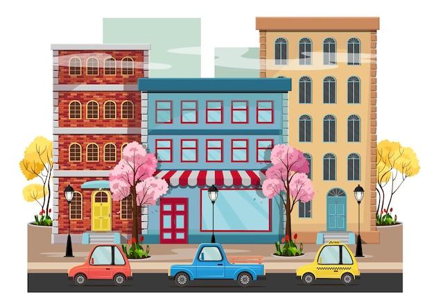 Panorama wiosennego miasta z kwitnącymi drzewami, domami, latarniami, drogą z samochodami.