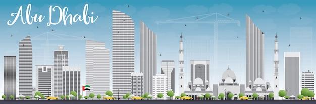 Panoramę miasta abu zabi z szarymi budynkami i błękitne niebo.