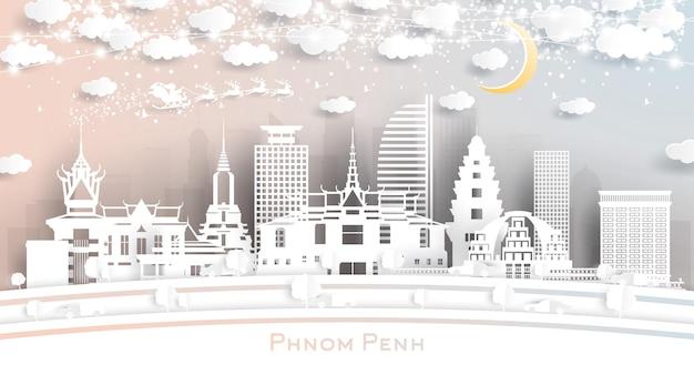 Panoramę miasta phnom penh w kambodży w stylu paper cut z płatkami śniegu, księżycem i neonową girlandą. ilustracja wektorowa. koncepcja boże narodzenie i nowy rok. święty mikołaj na saniach.