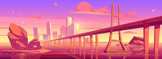 Panoramę miasta z budynkami i mostem nad jeziorem lub rzeką o zachodzie słońca.