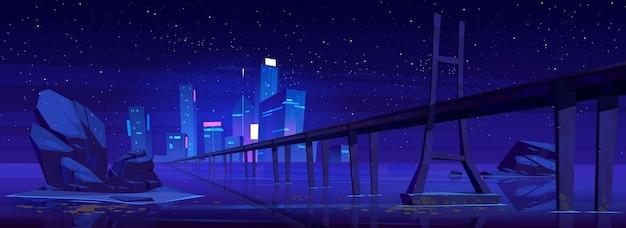 Panoramę miasta z budynkami i mostem nad jeziorem lub rzeką w nocy.