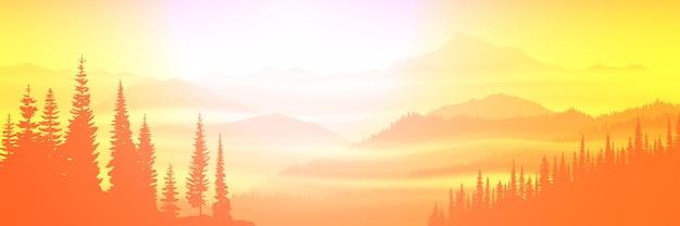 Panoramiczny widok na górski krajobraz o wschodzie słońca
