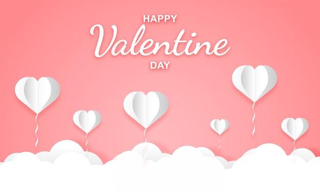 Papierowa sztuka jasnego różowego nieba z balonami w kształcie serca na walentynki