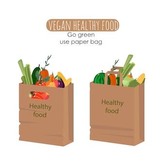 Papierowa torba na zakupy z warzywami i owocami dla ekologicznego życia. wegańska koncepcja zero waste. kolorowe, ręcznie rysowane ilustracji wektorowych na baner, kartę, plakat. powiedz nie plastikowi