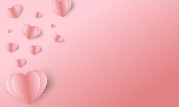 Papierowe latające elementy na różowym tle walentynki