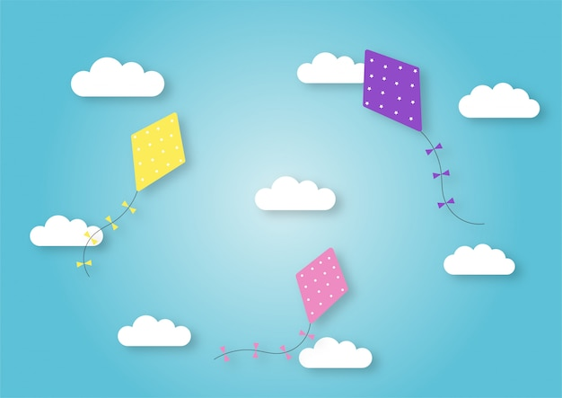 Papierowe latawce w stylu sztuki latające na tle nieba.