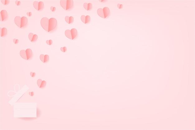 Papierowe serca unoszą się na różowym tle. walentynki