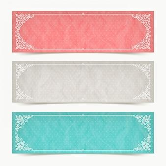 Papierowego koloru sztandary z zawijasami kaligraficzne eleganckie ornamentacyjne ramy - ilustracja