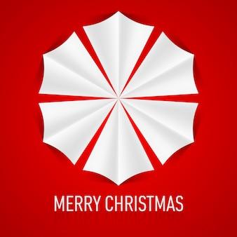 Papierowy płatek śniegu na czerwonym tle. kartka świąteczna.