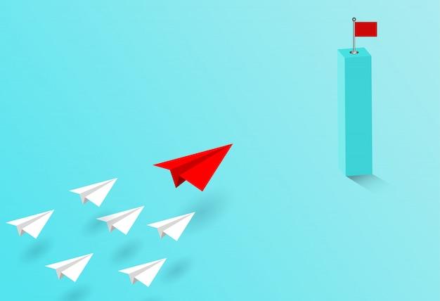 Papierowy samolot czerwony i biały konkurują, przejdź do celu.