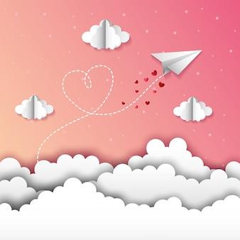 Papierowy samolot między chmurami