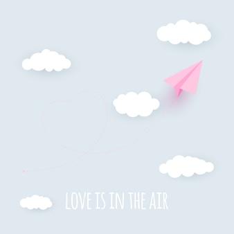 Papierowy samolot serce tło. miłość jest w koncepcji powietrza.