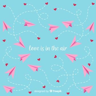 Papierowy samolotowy valentine dnia tło