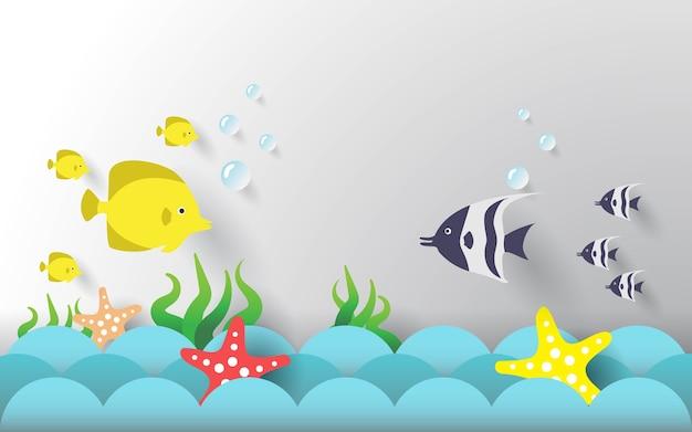 Papierowy styl. ryby i rozgwiazdy na falach oceanu.