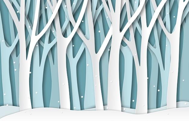 Papierowy zimowy las. białe zamrożone sylwetki drzew, naturalny krajobraz wycinany z papieru bożonarodzeniowego.