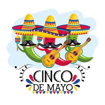 Papryczki chili w meksykańskim kapeluszu z marakasami i gitarami