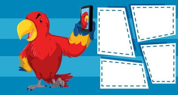 Papuga bierze selfie z pustymi ramowymi szablonami