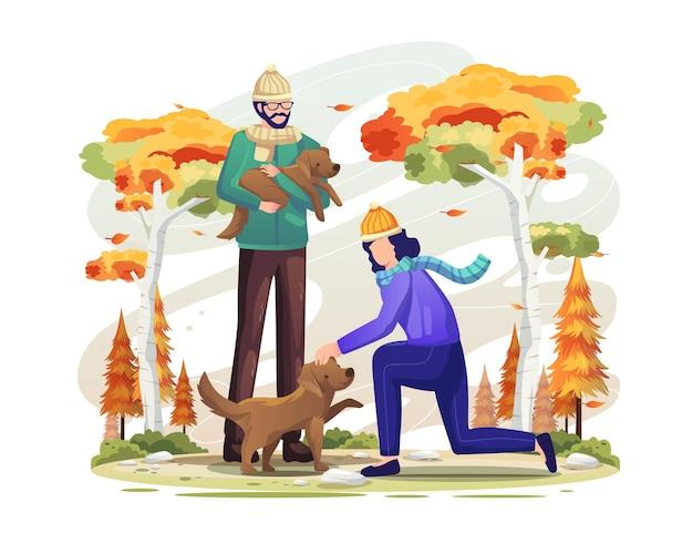 Para bawi się razem z psami w jesiennej ilustracji wektorowych