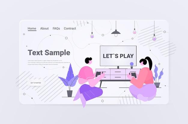 Para bawiąca się grając w gry wideo mężczyzna kobieta za pomocą bezprzewodowych gamepadów kontrolerów gra e-sport rozrywka przemysł gier