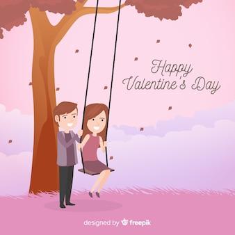 Para bawić się z huśtawkowym valentine tłem