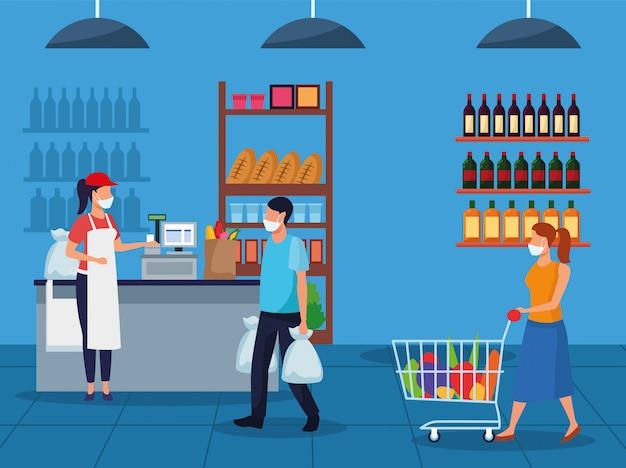 Para i pracownik używa twarzy maski w supermarkecie