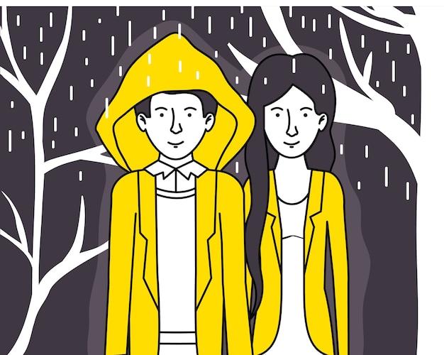Para kochanków z żółtymi ubraniami chodząc pod deszczem