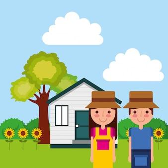 Para ogrodnik z słoneczniki drzewo domu