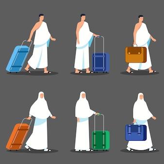 Para pielgrzymów ciągnąc teczkę czeka na wyjazd
