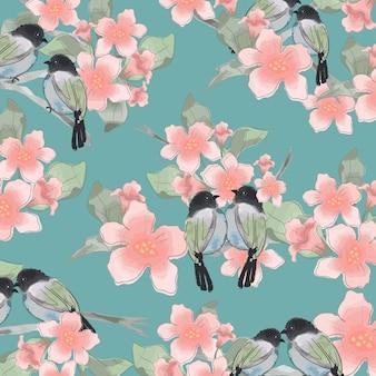 Para ptak i kwiat w lesie.
