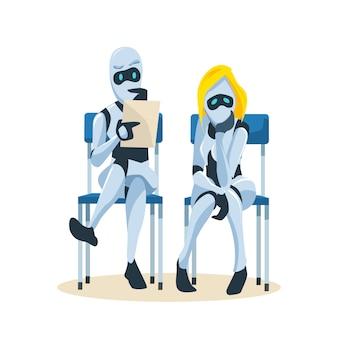 Para robotów siedzi na krześle i czeka na rozmowę o pracę