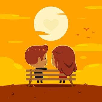 Para siedzi razem na zachód słońca